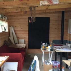 Garden studio and study, fully insulated and double glazed with a wood burner for winter warmth.