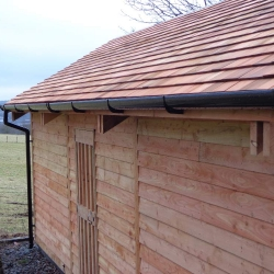 Larch Garage. With Cedar shingle roof