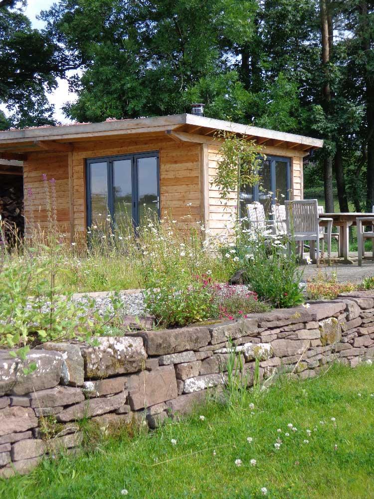 Test graham sandals garden rooms studios and garages for Garden studio uk