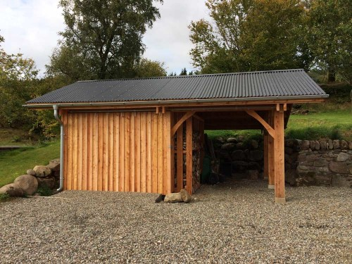 Larch Wood store and Garage with a corrugated steel roof.