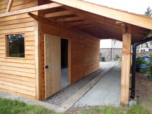 Larch Garage with a generous overhang for storing logs.