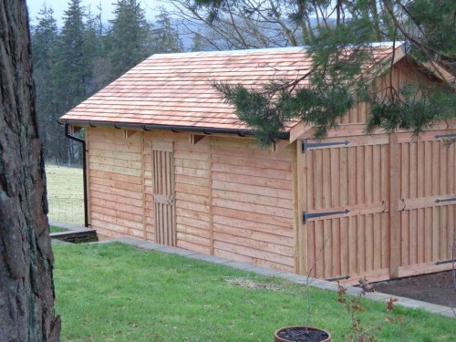Larch Garage with a Cedar shingle roof.