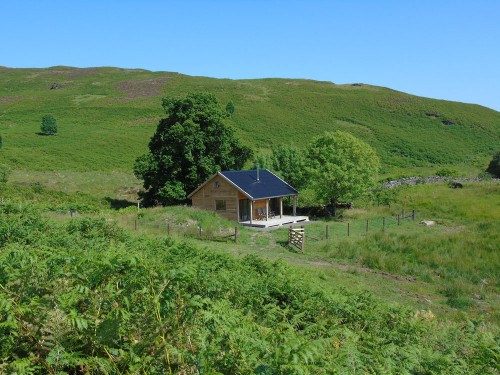 Larch Off Grid Bothy, fully insulated and double glazed. It has a mezzanine sleeping area a wood burning stove for heating and cooking. There is a shower and composting toilet on the rear veranda.
