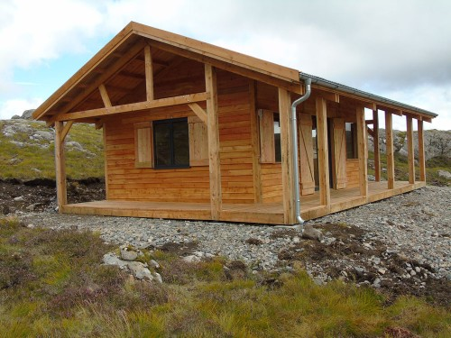 Larch Off Grid Hut, fully insulated and double glazed. It has a wood burning stove for heating and cooking. Shutters allow you to batten down the hatches when the weather gets really bad.