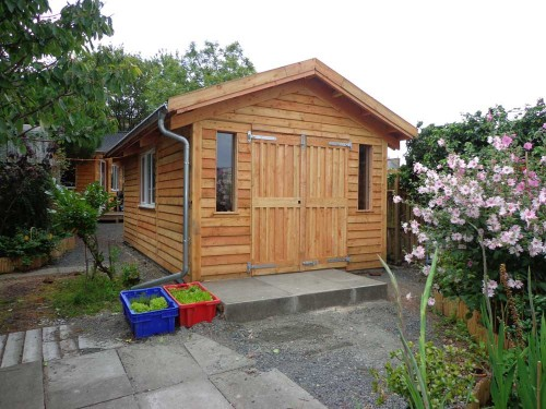 Larch Work Space / Store room, fully insulated and double glazed.